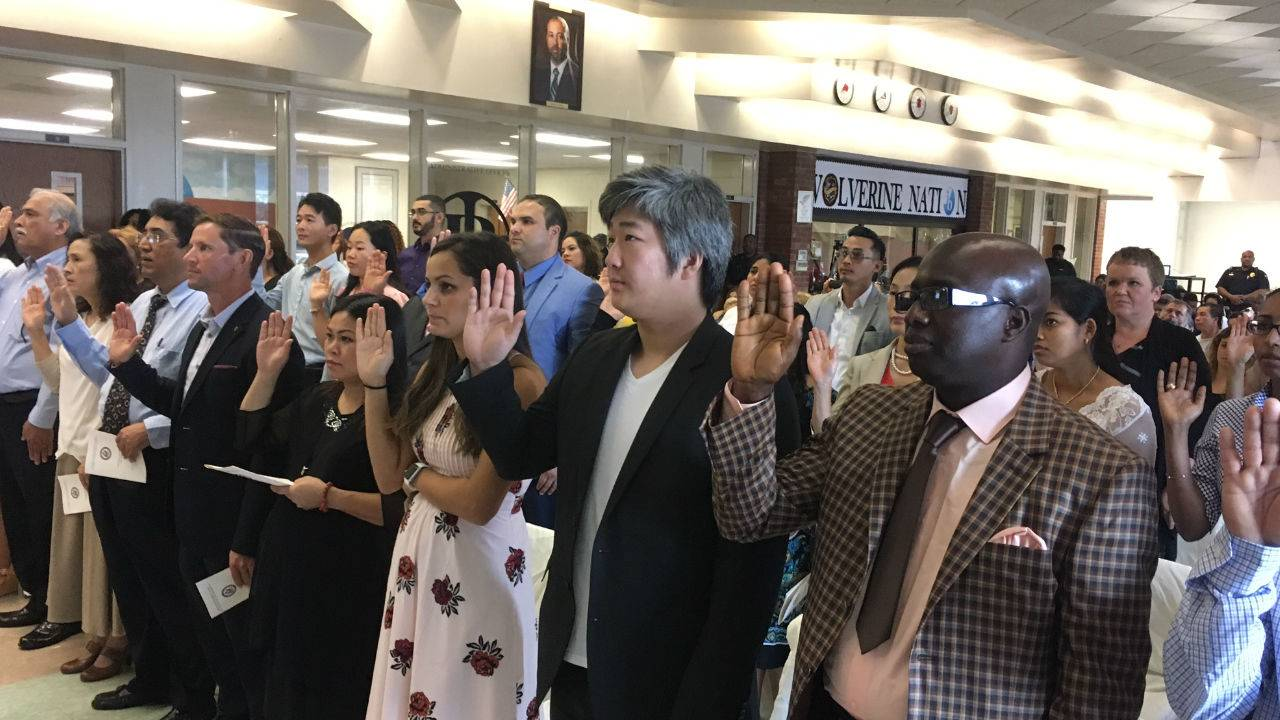 Immigrants Celebrate Citizenship As Controversy Continues