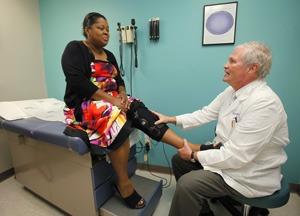 Dr. G Scott Morris helping a patient