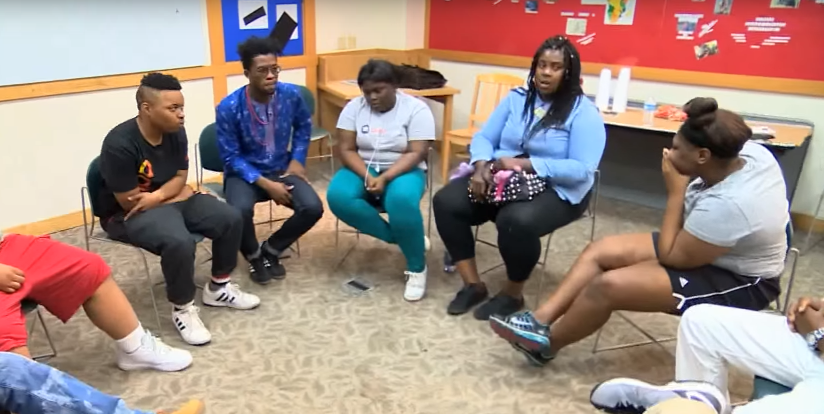 Abioye works with youth at the West Englewood Library