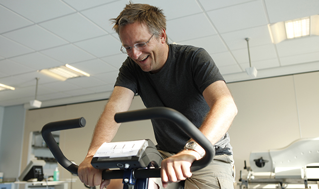 Dr. Michael Mosley on an exercise bike at University of Nottingham Medical School. He is performing his first ever session of High Intensity Training (HIT) on an exercise bike.