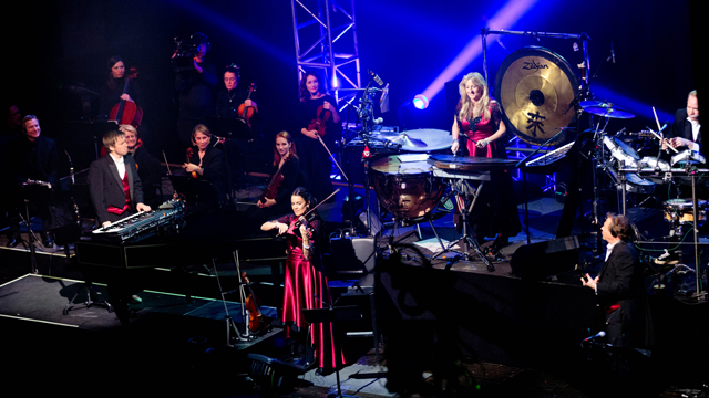Mannheim Steamroller perform onstage.