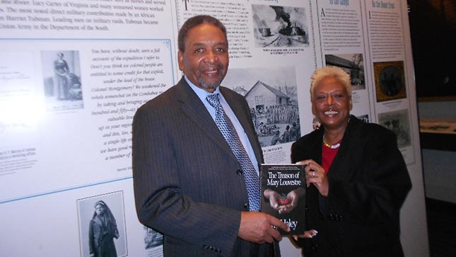 Author Dr. My Haley with Dr. Frank Smith, director of the African American Civil War Memorial & Museum in Washington, D.C. The exhibit behind them explores the life of Mary Louvestre, whom Haley based her book on.