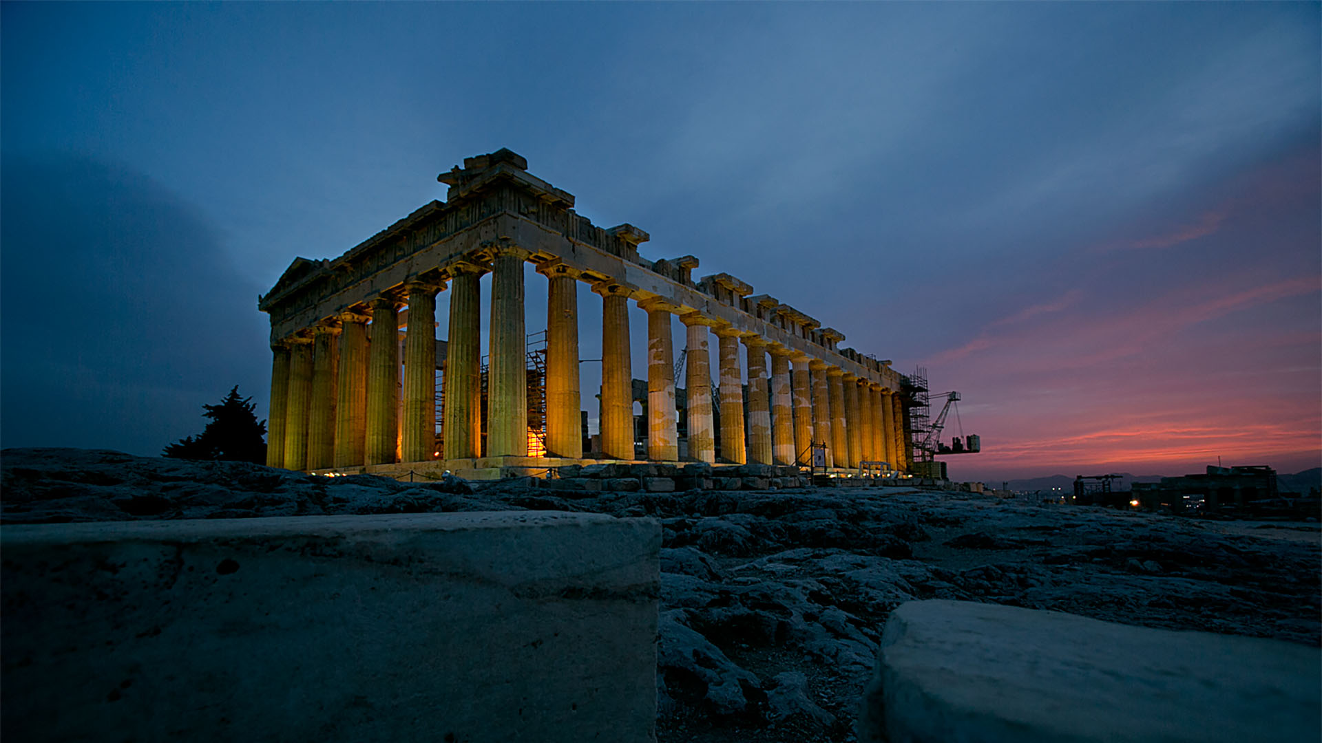 The Parthenon lights up as the Sun dips below the horizon.