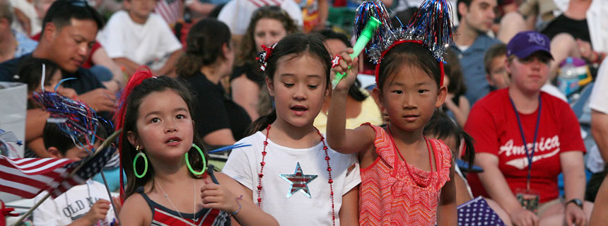3 young girls celebrating at the 2010 A Capitol Fourth concert