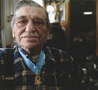 """Knappie"" proudly displaying his Medal of Honor"