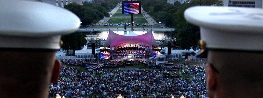 Soldiers looking from the Speakers balcony at the live concert  on the west lawn