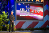 Host Joe Mantegna onstage at the 25th annual National Memorial Day Concert on the West Lawn of the U.S. Capitol, May 25, 2014, in Washington, DC.