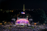 The program illuminates the night sky along the National Mall for the 25th annual National Memorial Day Concert on the West Lawn of the U.S. Capitol, May 25, 2014, in Washington, DC.