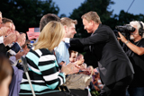 Host Gary Sinise (R) greets Marine Sgt. John Peck (L), who was severely wounded in Afghanistan, at the 25th annual National Memorial Day Concert on the West Lawn of the U.S. Capitol, May 25, 2014, in Washington, DC.
