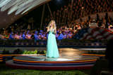 "Jackie Evancho performs ""Somewhere"" at the 25th annual National Memorial Day Concert on the West Lawn of the U.S. Capitol, May 25, 2014, in Washington, DC."