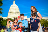 John Peck and family pose for a picture before the 25th National Memorial Day Concert on the West Lawn of the U.S. Capitol, May 25, 2014, in Washington, DC.