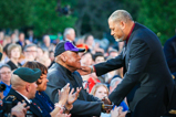 Actor Laurence Fishburne greets honoree Ted Strong during the 2015 National Memorial Day Concert.