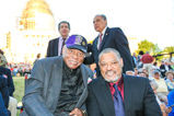 Actor Laurence Fishburne poses with honoree Ted Strong before the 2015 National Memorial Day Concert.