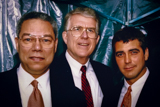 Gen. Colin Powell, Executive Producer Jerry Colbert and George Clooney TALK backstage at the 1995 National Memorial Day Concert.