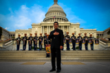 Joe Mantegna stands on the steps of the U.S. Capitol with the U.S. Army Herald Trumpets at the National Memorial Day Concert.