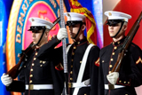 The U.S. Marine Corps Color Guard stands at attention for their service song during the Salute to Services each year on the National Memorial Day Concert.