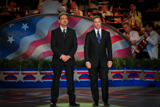 Joe Mantegna and Gary Sinise became co-hosts of the National Memorial Day Concert in 2005.
