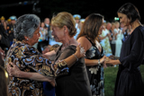 Dianne Wiest and Katie Holmes embrace the family of wounded veteran Jose Pequeno on the 2009 National Memorial Day Concert.