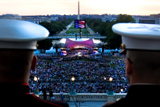 Two service members watch the National Memorial Day Concert on the West Lawn from the United States Capitol Building.