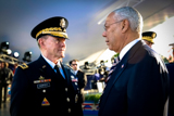 Gen. Colin Powell and Gen. Martin Dempsey speak on the set of the National Memorial Day Concert.