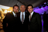 Alfie Boe, Gen. Colin Powell, and Chris Mann pose backstage on the set of the National Memorial Day Concert
