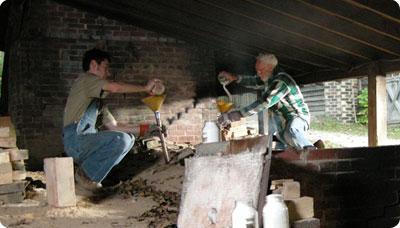 Travis and Vernon Owens salting the kiln, 2008