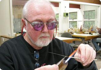 Paul Stankard flameworking at his torch in his New Jersey studio, 2009