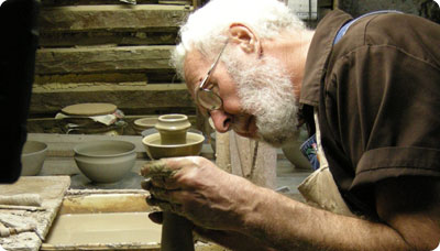 Vernon Owens throwing a candlestick on the wheel, a form for which Jugtown Pottery is famous, 2008.