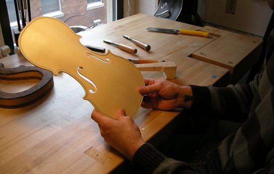 Head instructor of Violin making at North Bennet Street School, Roman Barnas, helps his student