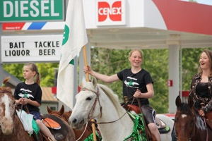 Jordan Stoltz carries the 4-H flag in a Valier, MT Parade