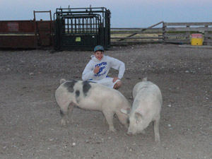 Mitch Ward shows off two of his favorite pigs