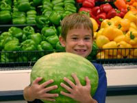 Grocery shopping becomes an opportunity to learn about fruits and vegetables.