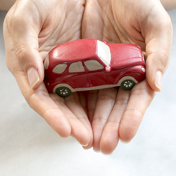 Small Car Being Held in Hand