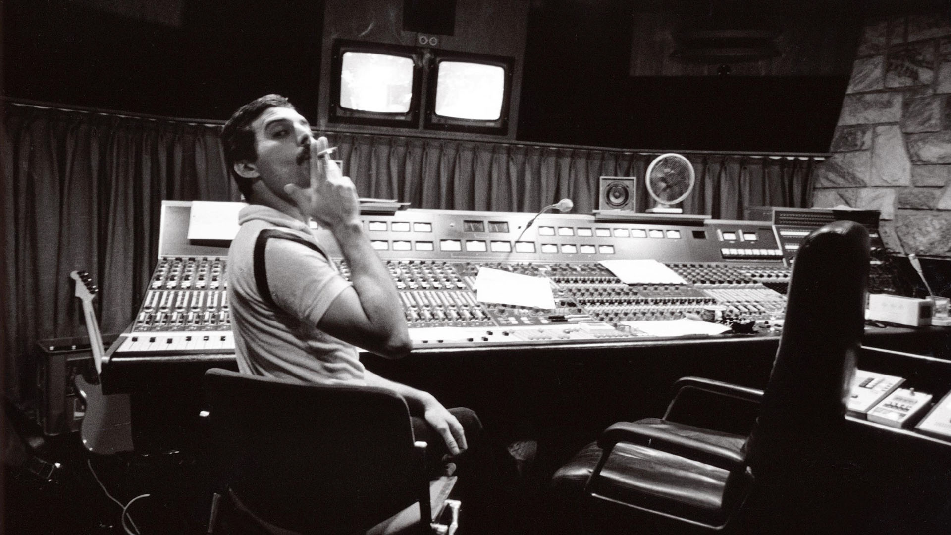 "Freddie Mercury and Brian May record ""One Vision"" in the studio in 1985."