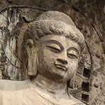 face of empress wu on giant sculpture carved into cliff