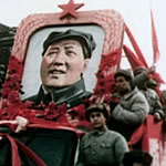 men carrying portrait of Mao Zedong