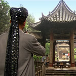 man dress in Islamic clothing in front of a Chinese mosque