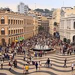 people walking in a plaza