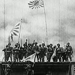 Japanese soldiers waving Japanese flag
