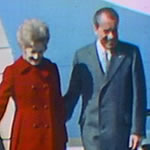 Richard and Pat Nixon stepping off an airplane