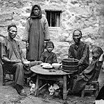 black and white photo of poor Chinese family