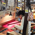 a woman working at a loom