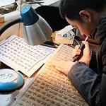 man creating Chinese woodblock printing template