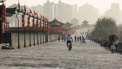 man on bicycle riding along the walls of Xi'an