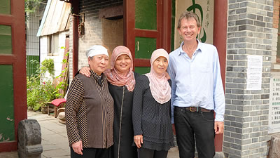 Michael Wood standing with 3 Muslim Chinese women