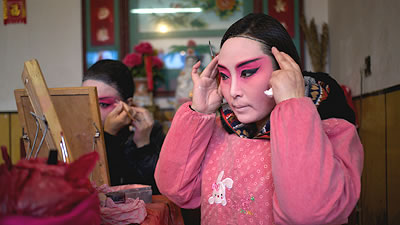 Chinese actors putting on make-up