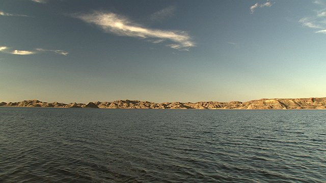 Fort Peck Lake stretches 134 miles upstream of the dam, storing over 18 million acre feet of water.