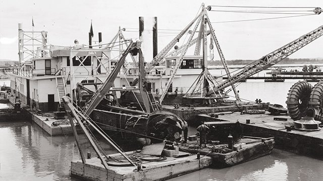 The dredge Jefferson and its pump boat were used to pump sediment to form the dam.