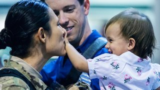 Star Lopez is all smiles as she returns from Afghanistan and is reunited with her husband and daughter.