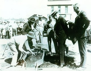 Calvin Coolidge panning for gold in the Black Hills